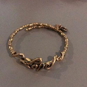 """Alex and Ani Gold """" Love"""" Bracelet."""